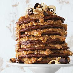 If only my husband liked nuts or coconut ... *sigh* German Chocolate Pancakes Recipe, from Southern cooking - ok, take a deep breath and allow yourself to get past having something this indulgent for breakfast - it will be sheer pleasure - we omit pecans in the sauce and double up on the coconut because of nut allergies - now this would be a great valentines breakfast!