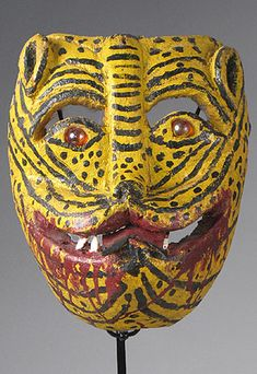 Tigre (Jaguar) Mask  Sierra de Puebla, State of Puebla, Mexico    7 Inches, painted wood, marbles    The Totonac Indians in Puebla may call this a dog or a Jaguar, depending on the village. These masks take part in the Danza de los Huehues, sometimes in other dances, but in this area there doesn't seem to be the classic Jaguar hunt dance that is so typical in the states of Guerrero and Oaxaca.