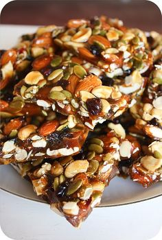 autumn brittle, YUM! 1 Cup Almonds  1 Cup Cashews  3/4 Cup Pumpkin Seeds  2/3 Cup Dried Cranberries   1 1/2 Cups Golden Brown Sugar  1 Cup Granulated Sugar  1/2 Cup Honey  1 Cup Water  1/2 Teaspoon Salt  1 Tablespoon Butter