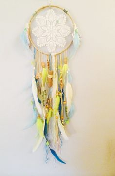 Dreamy Mermaid dreamcatcher with aqua and yellow with vintage doily lace by Rachael Rice: https://www.etsy.com/listing/171316423/dreamy-mermaid-dreamcatcher-with-white?ref=listing-shop-header-2