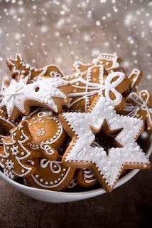 Iced gingerbread cookies for Christmas time. Stars, trees and snow.