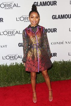 Yara Shahidi  in a colorful blouse and vest dress  by Cynthia Rowley Spring 2017.