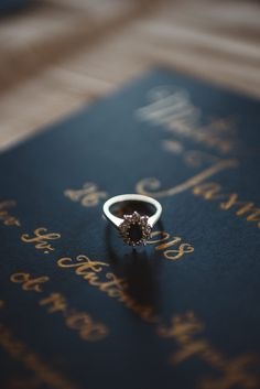 A gorgeous engagement ring with a dark blue stone, perfect for a romantic bride with lots of style.