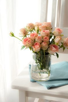 lots of small vases of spray roses and candles on the tables -- easy, inexpensive and very beautiful