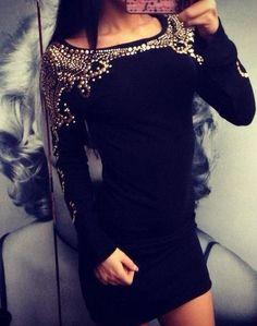Black dress with gold embellishment.