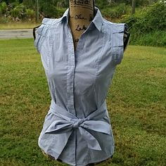 Zara blouse Very cute Zara blouse button down with a little pleat to the sleeve collared with a tie around the waist 100% cotton size small Color: Grey Zara Tops Blouses
