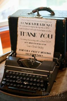 I would use a vintage typewriter so the guests could type out their well wishes and we'd turn the pages into the guestbook later!