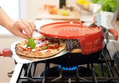 Pizzacraft has made stovetop spinoff to their Pizzeria Pronto Outdoor Pizza Oven. It's called the Pizzeria Pronto Stovetop Pizza Oven. Don't worry, I'm sure the design and performance are a lot more inspired than the name. Stovetop Pizza, Home Pizza Oven, Portable Pizza Oven, Cool Kitchen Gadgets, Smart Kitchen, Cool Kitchens, Kitchen Gifts, Perfect Pizza, Love Pizza