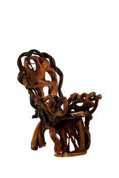 Amazing 1960's chair made from wood and vines with no nails used.  Magic