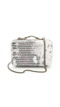 Follow #MaterialWrld and repin this image for a chance to win this bag! House of Harlow 1960 Marley Clutch