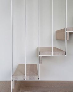 Minimal simple stairway design. White steel frame and wood structure.
