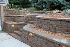 Retaining wall idea...love the stone