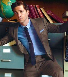 Shia LeBeouf nailing brown suit by finding its natural ally, the blue shirt.