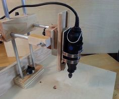 There are some really good Instructables showing how to make a Dremel/rotary tool drill press