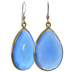 I love the subtle pop of cool color in these teardrop earrings. They're super light and the facets in the blue chalcedony reflect the light beautifully.