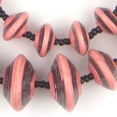 Beautiful strand of larger size pink and black recycled paper beads. These beads are made using recycled paper by working mothers in Uganda. Each bead is fair trade and handmade with love. Individual