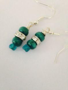 A personal favorite from my Etsy shop https://www.etsy.com/listing/243953232/teal-earrings-dangly-earrings-nickel