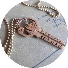 Our designs   Your choice of wordsTHIS ITEM IS/Made To Order*/Hand cut design on a key/Ball chain/Approx. 15 inch dropHOW TO ORDER/Design, with the scroll bar below, choose once of our existing designs for the image you would like to appear in the top portion of the key./Text, choose two to three words you would like to appear on the top and bottom on the key. 9 letter max on each half of the key. Dates are an option as well as text./Upon check out, there wil...