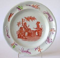 Staffordshire Orange Transferware Print of Monkeys Playing Cards with Raised Border of Animals Colored in Enamels and Pink Lustre