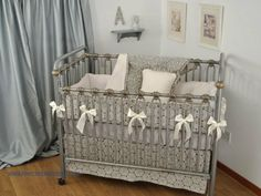 Charcoal crib bedding with ivory for a gender neutral bedding set with a geometric pattern