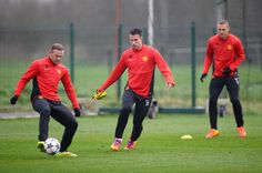 Wayne Rooney and Robin Van Persie of Manchester United in action during a training session at Aon Training Complex on March 18, 2014 in Manchester, England