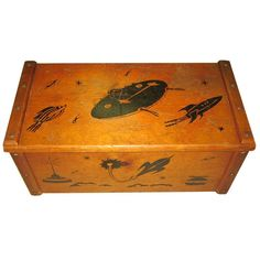 Vintage toy chest with rockets. I know I would have loved this as a kid because I love it as an adult.