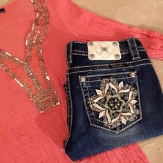 JUST IN! Lotus Flower Miss Me Cuffed Capri Rolled cuffs keep things cool and casual on these medium wash capri's, finished with colorful lotus flower design on back pockets, trimmed with fading, whiskering and silver logo hardware. ·  Signature rise ·  Front Rise: 7 1/2″ ; Back 12 1/2″ ·  Inseam: 20″ ·  98% COTTON 2% ELASTANE Miss Me Jeans Ankle & Cropped