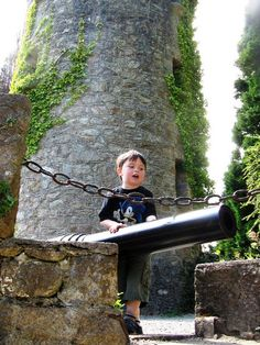 A little boy enjoying his visit to Tower Valley and the canons at the Pepperpot Tower in Powerscourt Gardens, County Wicklow, Ireland. www.powerscourt.ie