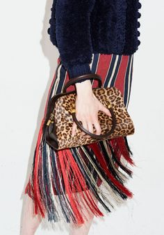 The Curious Appeal of Pieces That Clash - T Magazine - Dries van Noten skirt and Tod's bag