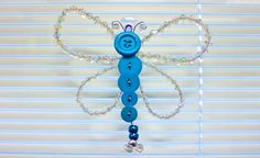 Use crafting wire to create a beautiful crystal dragonfly to hang in the window and capture the sunlight!