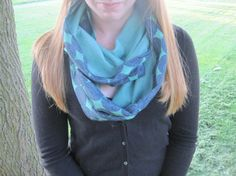 Make life colorful with this fun double-sided blue and aqua infinity scarf. One size fits most. Double wrapped around the neck in this photo. Get it on Etsy!