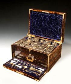19th Century silver gilt, gilt metal and cut glass ladies travelling dressing table service all in a brass bound coromandel case with sunken brass handles.