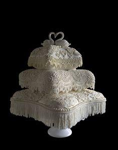 Big Island Wedding Cake – Wedding Cake – Pahoa, HI – WeddingWire White fondant pearls lace pillow wedding cake with white sugar swans cake toppers. Amazing Wedding Cakes, Elegant Wedding Cakes, Elegant Cakes, Amazing Cakes, Beautiful Cakes, Wedding Cake Prices, Wedding Cake Designs, Wedding Cake Toppers, Cupcake Wedding