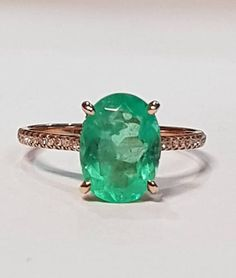 Emerald diamond ring. 18k gold colombian emerald ring with