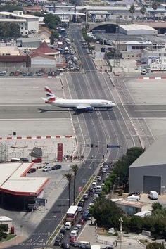 Gibraltar Airport, Gibraltar, British Territory The runway crosses a highway as the stopped cars attest. Gibraltar airport serves both military and passenger traffic and is located close to the famous Rock of Gibraltar. Rock Of Gibraltar, Places To Travel, Places To Go, Scary Places, British Overseas Territories, British Airways, Air Travel, International Airport, Military Aircraft