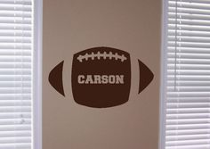 love football themed little boys room and this wall decal is adorable.
