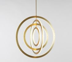 Halo vertical chandelier 4 rings brushed brass by Roll & Hill | General lighting