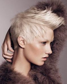 i love this haircut! for one of my cosmetology class projects, we have to pick a haircut and formulate a color for it; this is pretty masculine, but the color feminizes it and looks like something an actual pixie would wear. I'm going to do this cut, then make it a red violet, or some other edgy color. so excited!