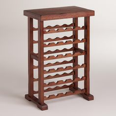 Our Verona Wine Rack in a rich mahogany finish is an excellent way to store a large amount of wine in a compact space. Made in Thailand from eco-conscious rubber wood, this stylish wine rack holds most sizes of your favorite vintages. Tall Wine Rack, Wine Rack Bar, Wine Bottle Rack, Wine Glass Holder, Bottle Labels, Wine Bottles, Unique Wine Racks, Rustic Wine Racks, Wine Shelves