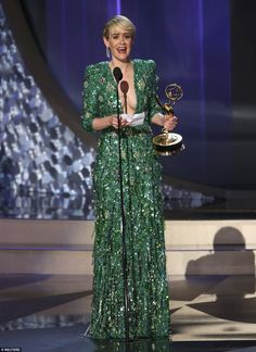 Gorgeous in green: Sarah Paulson was excited as she accepted thegong for…