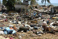 CC: A man walks around the ruins in Sri Lanka after the December 2004 Asian Tsunami.