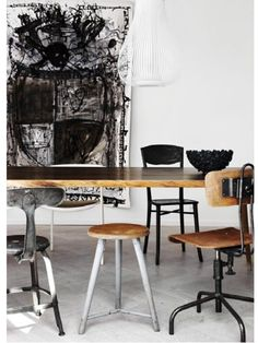 Chairs ..... THE painting is not my taste..THE black and white i like in this setting!
