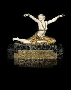 Claire Jeanne Roberte Colinet (French, 1880-1950) 'Theban Dancer' a Gilt Bronze and Carved Ivory Figure, circa 1925 circa