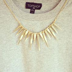 Gold jewellery + sweater