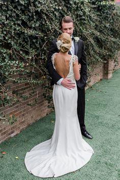 back showcasing amy kuschel wedding dress