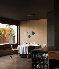 Morph chairs by Formstelle from Zeitraum looking elegant alongside these Vibia lights