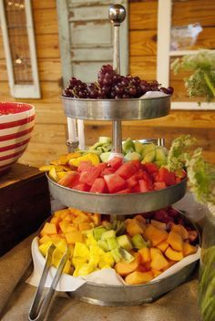 Fruit Bar Ideas fill a galvanized 3-tier stand with loads of fruit, pick wild