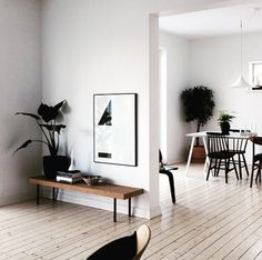 Pale floorboards with white walls, darker wood furniture (via @askogeng on Instagram)