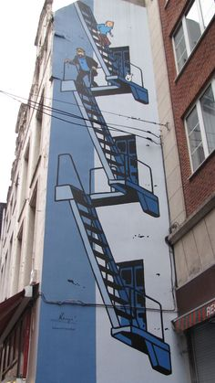Tin-tin street art in Brussels, Belgium. With signature from Hergé.