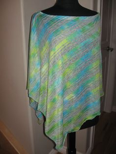 Stripe green modal/polyester poncho, one size, full coverage (your back and sides are fully covered), stylish and not just for breastfeeding, it's the perfect fashion accessory! Imported burn out effect fabric. 55$ only at http://www.uchimama.net St Albert (780)970-1006
